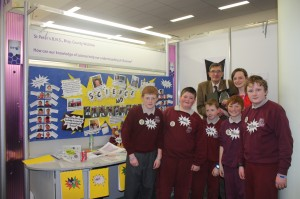 Proud St. Peter's students with a judge at the Primary Science Fair at the BT Young Scientist competition in the RDS